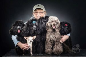 picture of Rebecca Riski with groomed poodles. They were cleaned using the best pet grooming supplies in Alaska.