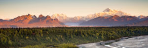 background of mountains in Alaska which is where pet groomer supply operates